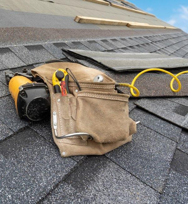 Yellow Nail Gun on Roof